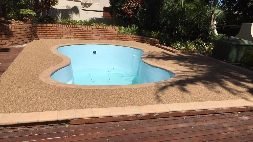 Pebble paving around a pool